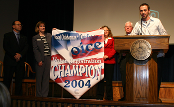 Photo of Student Body President Jacob Davis accepting a banner