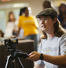 CU student operating a video camera