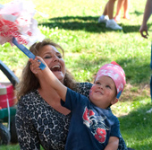 Photo of Rose State College student and her grandson celebrating the Fourth of July.