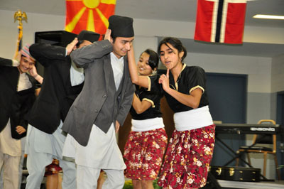 "Photo of Cameron University students performing the Nepalese ""flirting dance."""