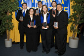Photo of Rose State College business students with award.