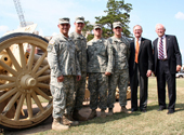Photo of three Army ROTC cadets, Pres. Burns Hargis and OSU Dean of Arts & Sciences.